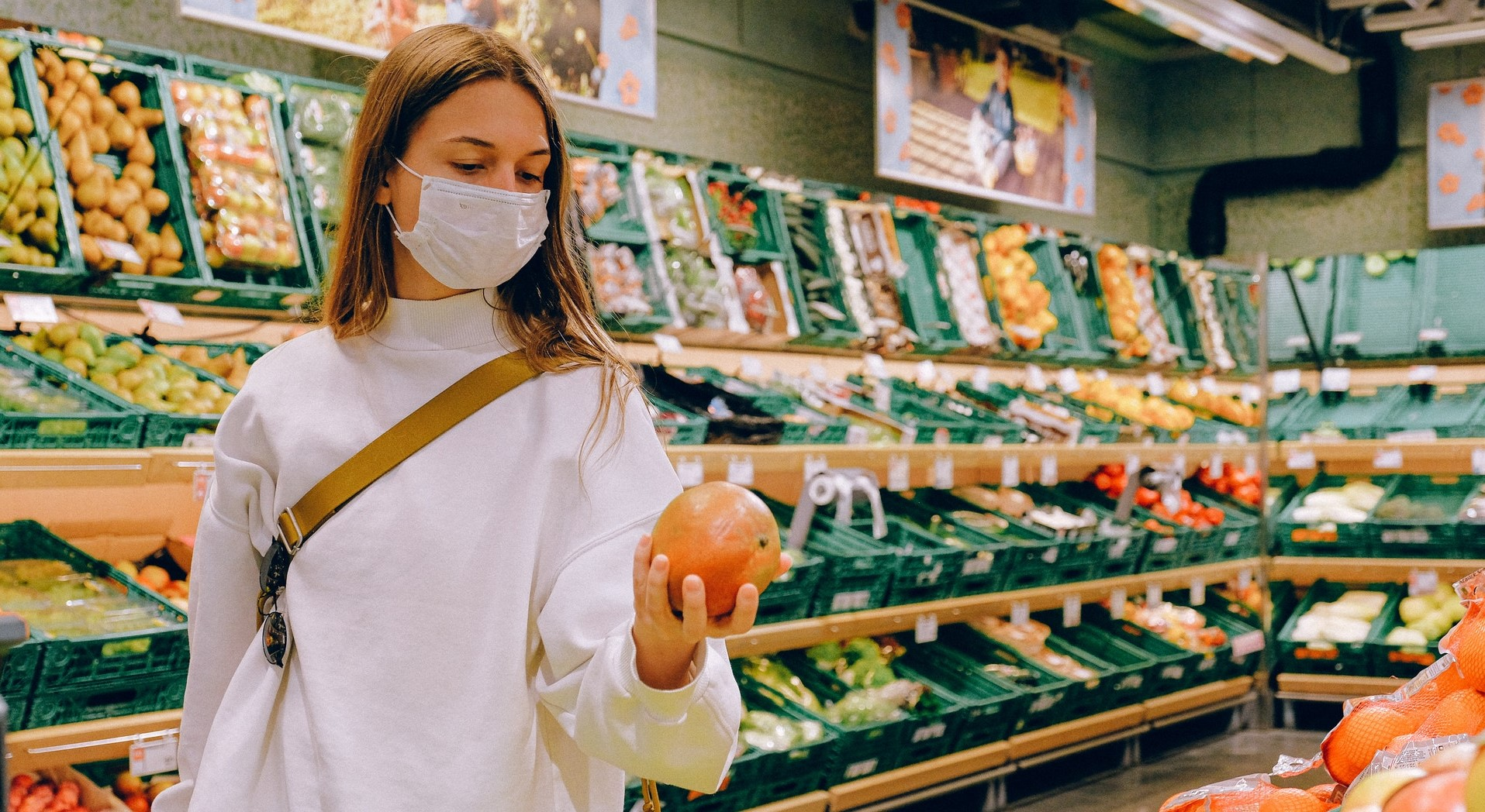 Woman Shopping Wearing Facemask Photo by Anna Shvets from Pexels header